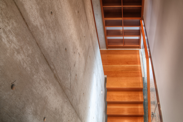 Monteyne Architecture | Residential - WY House - WHITE CONCRETE WALL AND CUSTOM DOUGLAS FIR STAIR